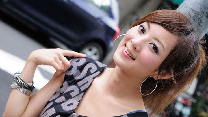 Asian Model Smiling In Pink Top Side Pose